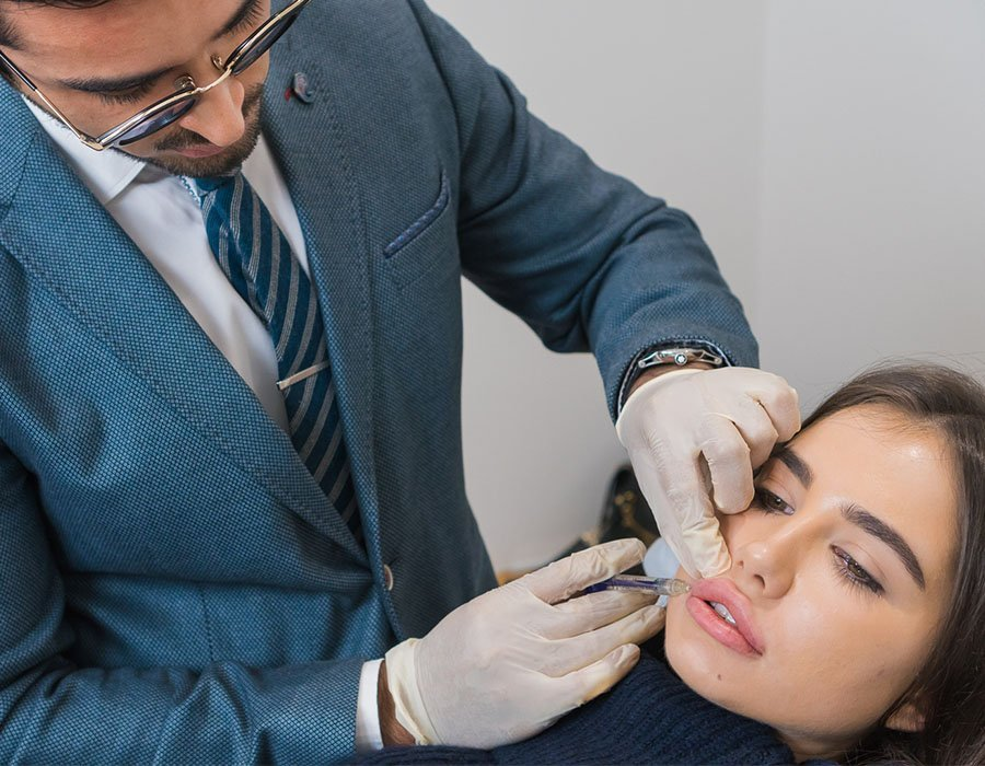 Dr Adil Sarwar, injecting dermal fillers
